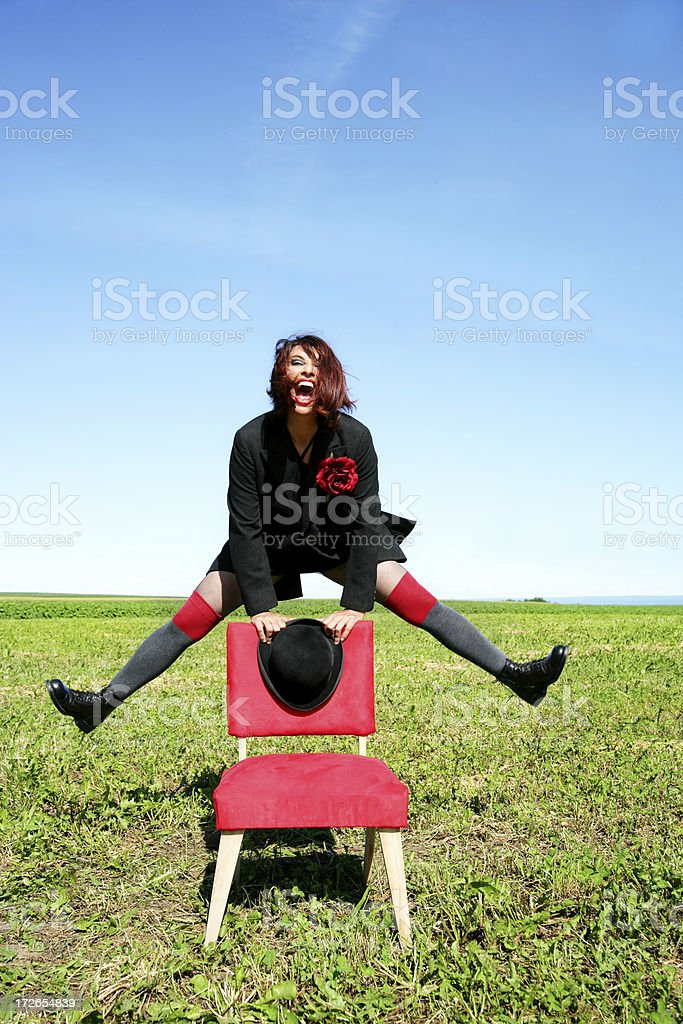 Playing with a red chair royalty-free stock photo