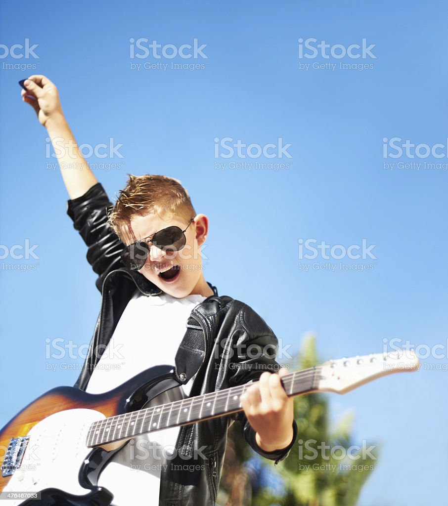 Playing with a rockstar attitude stock photo
