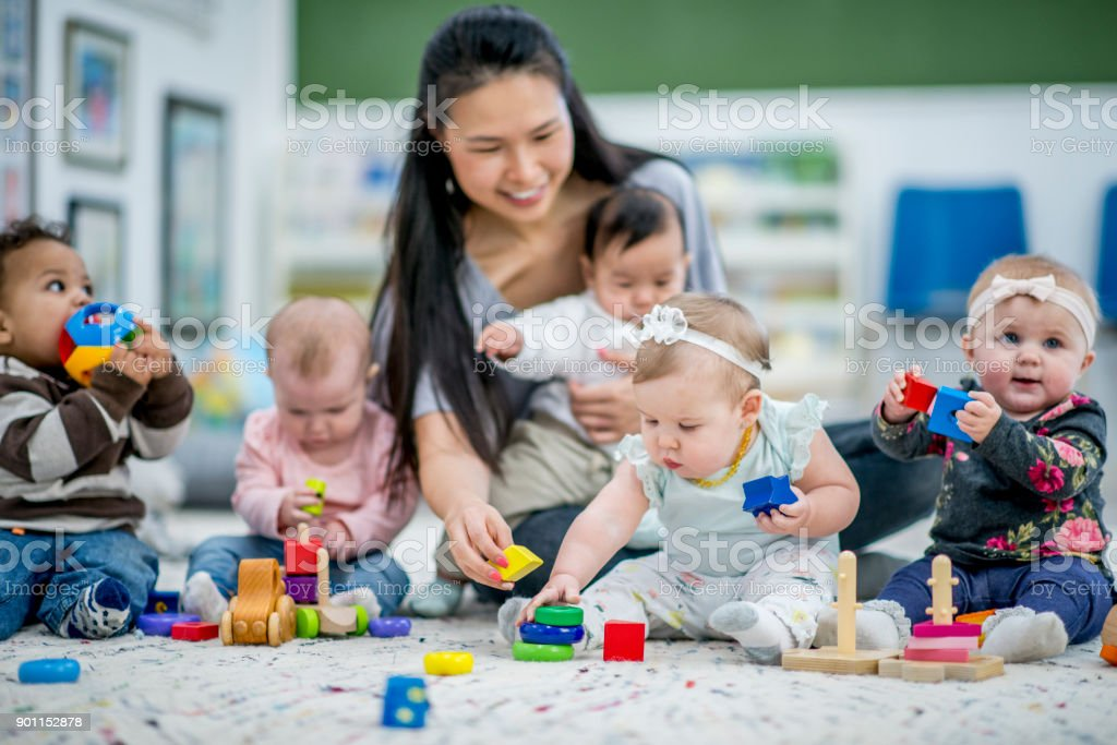 Playing With Babies stock photo