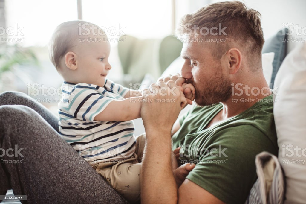 Playing with baby boy stock photo