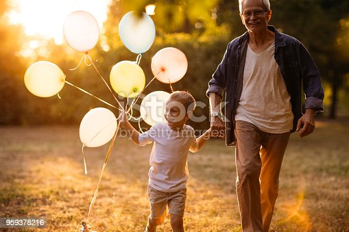 istock Playing with balloons 959378216