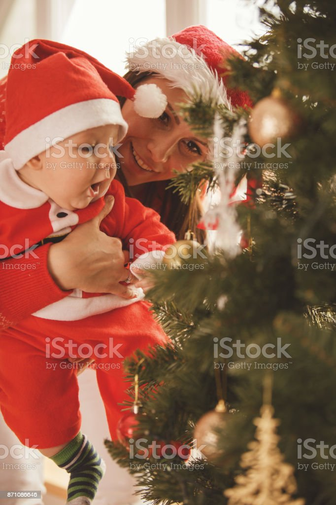 Playing with Christmas decorations stock photo