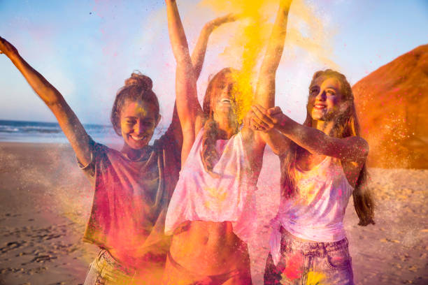 playing with colored powder - femme portugal photos et images de collection