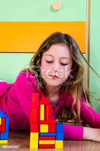 470874196istockphoto playing with construction toy blocks 685685062