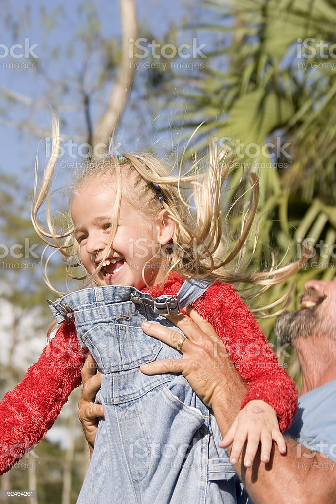 Playing with Daddy royalty-free stock photo