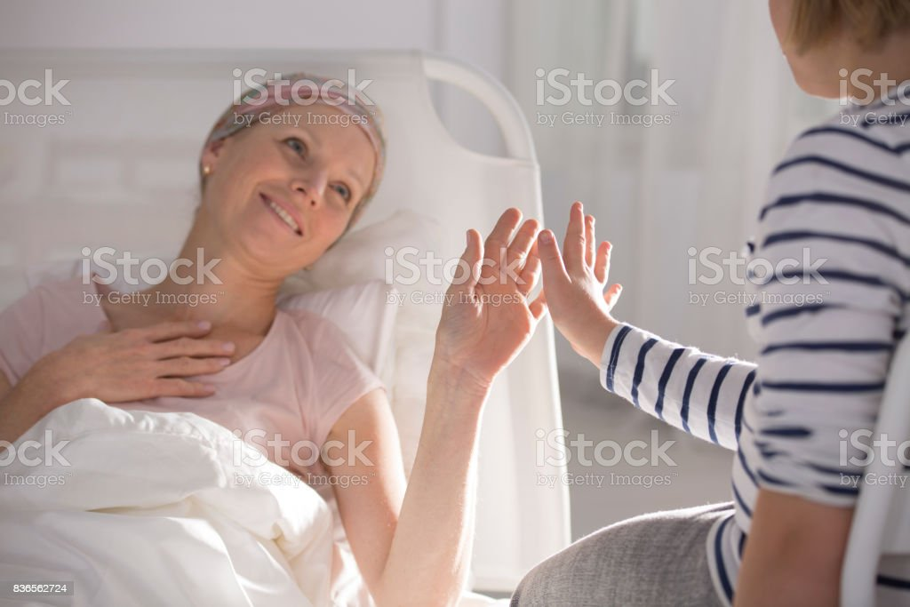 Playing with daughter in hospital stock photo