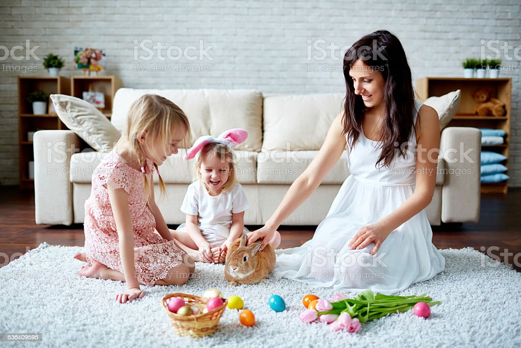 Playing with Easter bunny stock photo