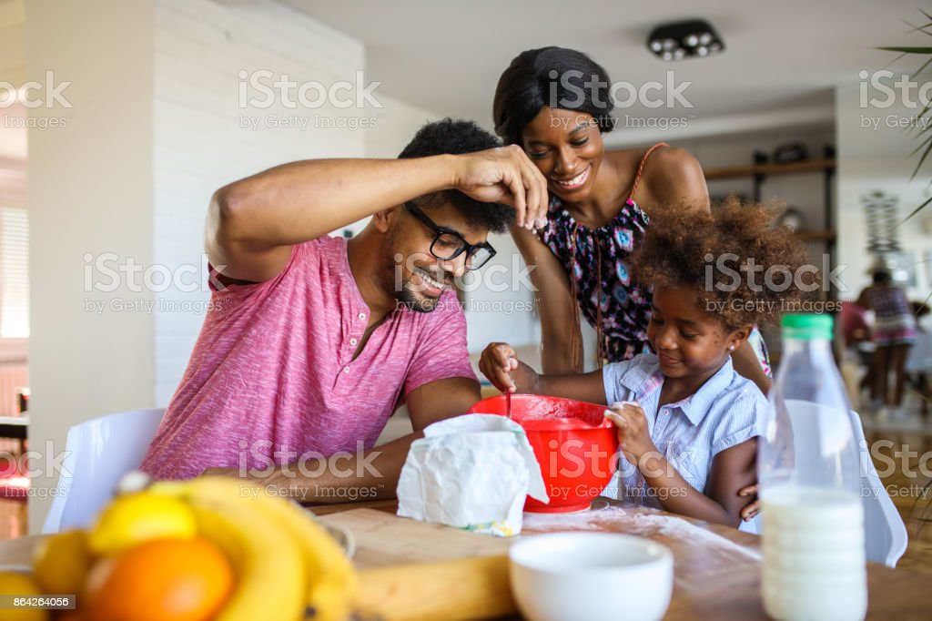 Playing with flour while making a cake in kitchen royalty-free stock photo