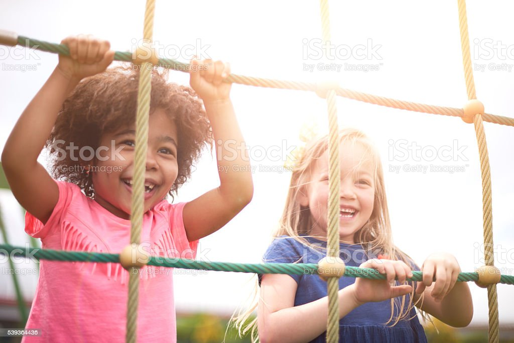 Playing with friend make you happier stock photo