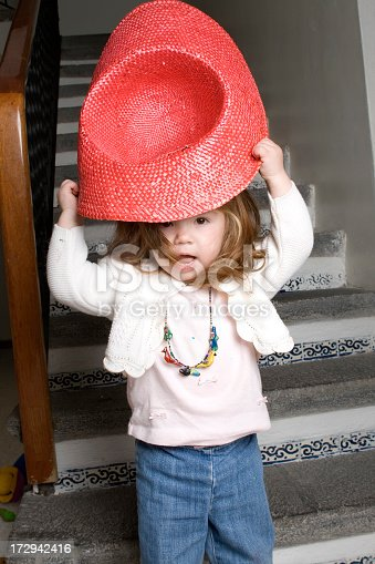 istock playing with hat 172942416