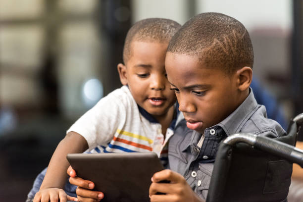 Playing with his little brother Eleven years old african american boy playing with his 3 years old brother haitian ethnicity stock pictures, royalty-free photos & images