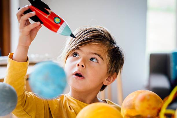 playing with his rocket - erforschung des weltalls stock-fotos und bilder