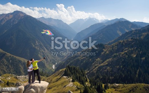 872969580 istock photo Playing with kite couple at summit 177012527