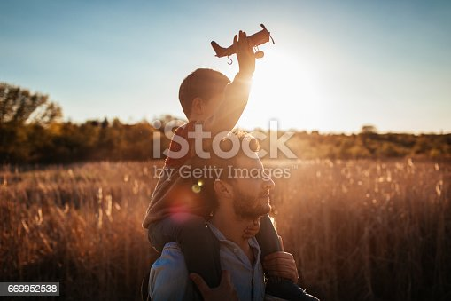 istock Playing with my dad outside 669952538