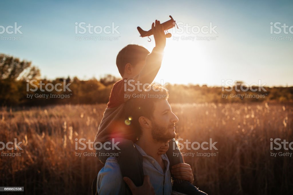 Playing with my dad outside stock photo