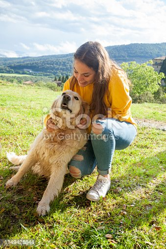 istock Playing with my dog in the meadow 1149428644