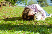 istock Playing with my dog in the meadow 1149428647
