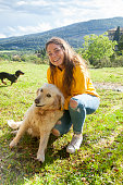 istock Playing with my dog in the meadow 1149428652