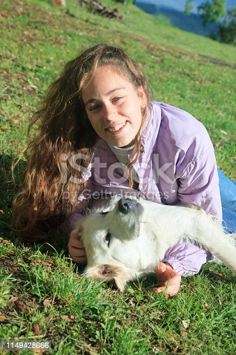 istock Playing with my dog in the meadow 1149428666