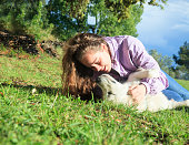 istock Playing with my dog in the meadow 1149428689