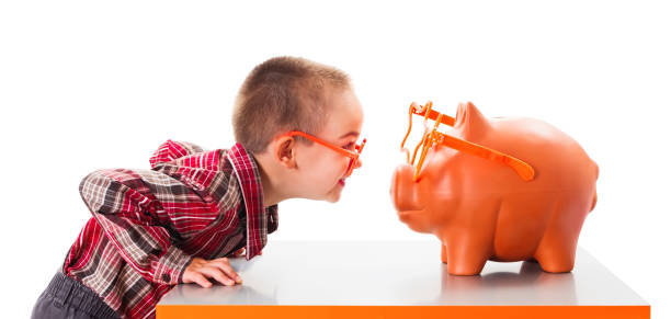 Playing with Piggy Bank stock photo