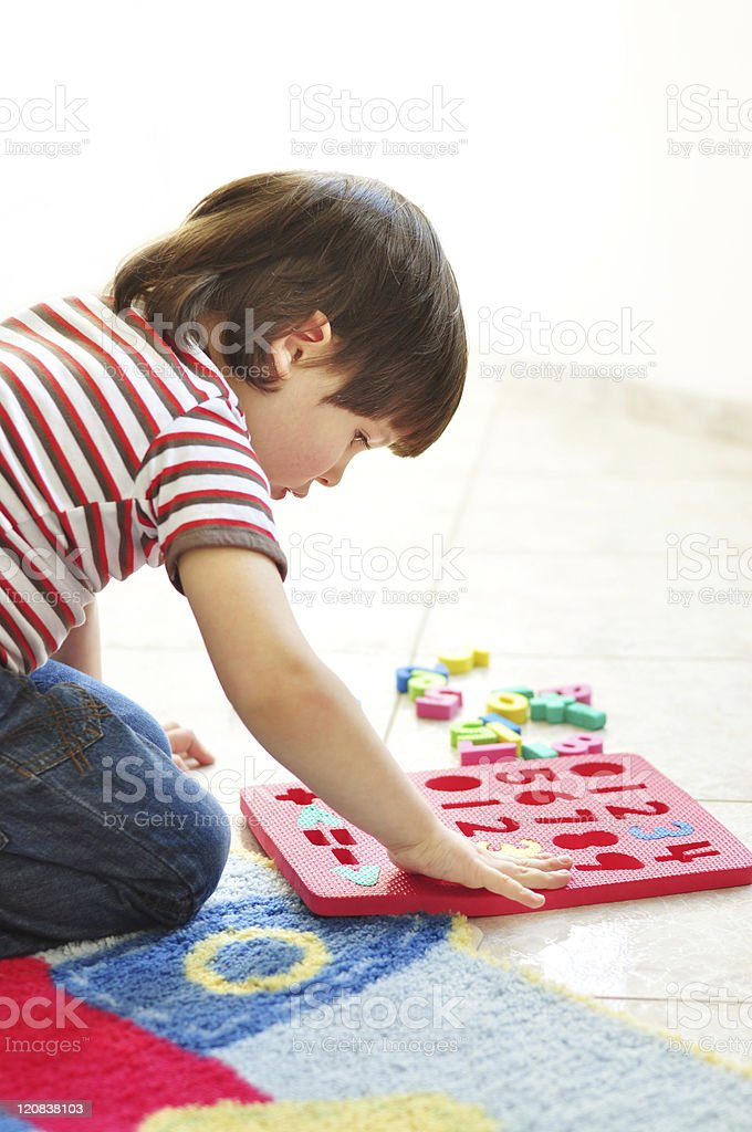 Playing with puzzles stock photo