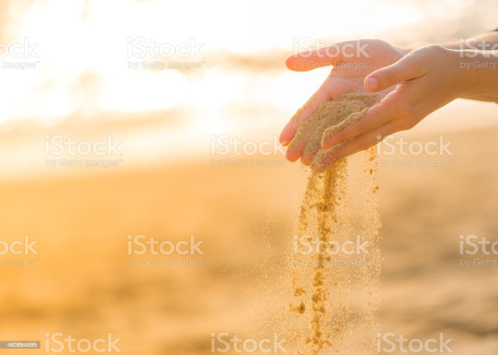 playing with sand  on the beach royalty-free stock photo