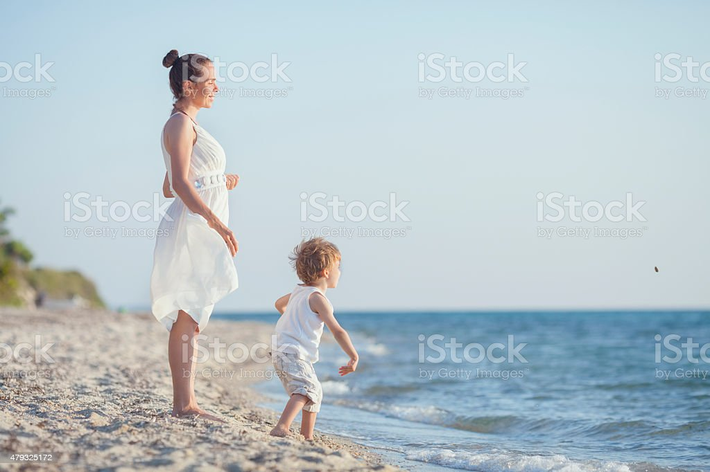 Playing with Skimming Stones on the Beach stock photo