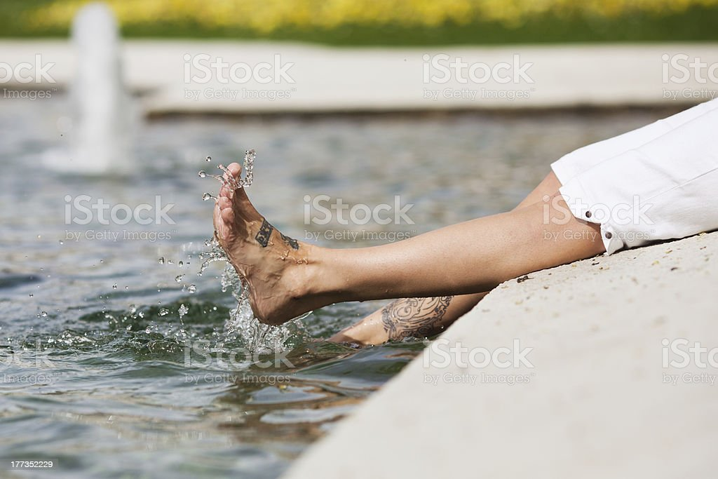 playing with the feet in water stock photo