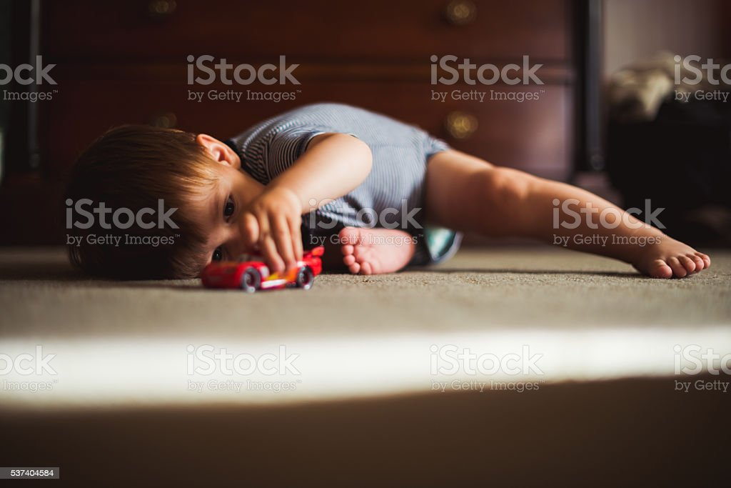 Playing with toy cars stock photo