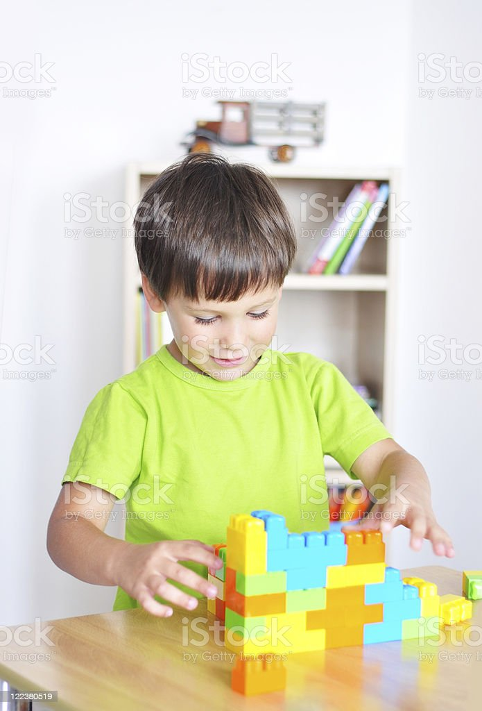 Playing with toy construction blocks stock photo