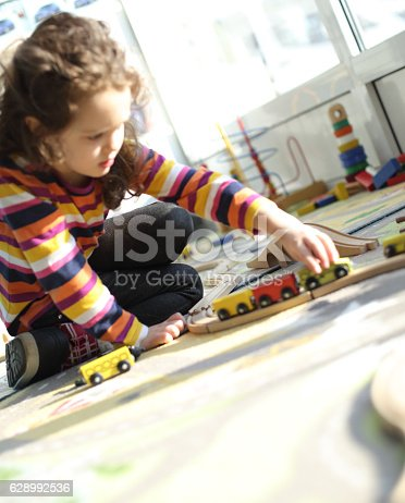 istock Playing with toy train 628992536