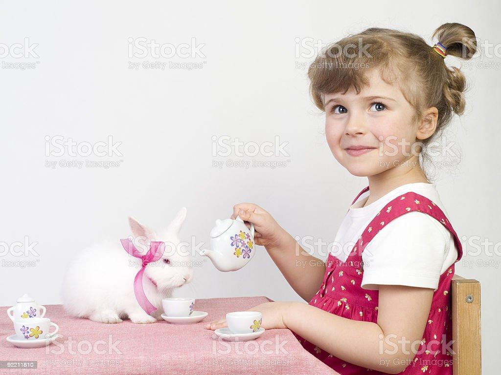 Playing with white rabbit royalty-free stock photo