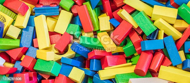 Colorful wooden toy blocks in a box