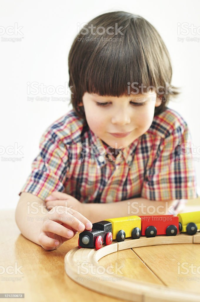 Playing with wooden train stock photo