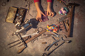 A child reaching out for tools to play and create new stuff