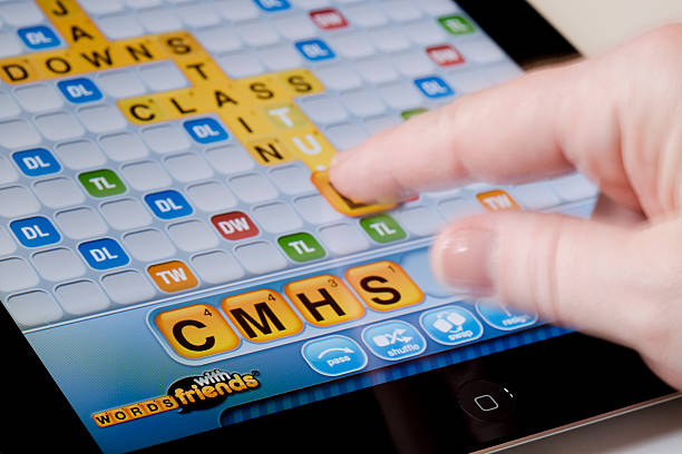 Playing Words with Friends on an iPad Horizontal stock photo