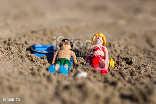 playmobil mann und frau figur sonnenbaden am strand stock. Black Bedroom Furniture Sets. Home Design Ideas