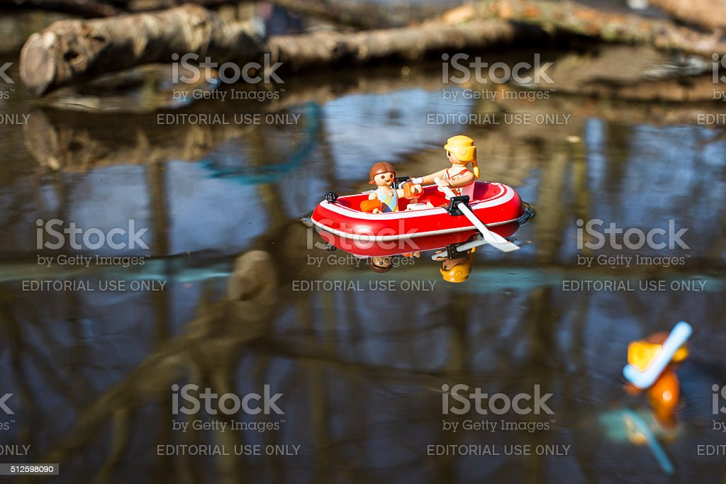 Playmobil woman and child figurines on a boat stock photo
