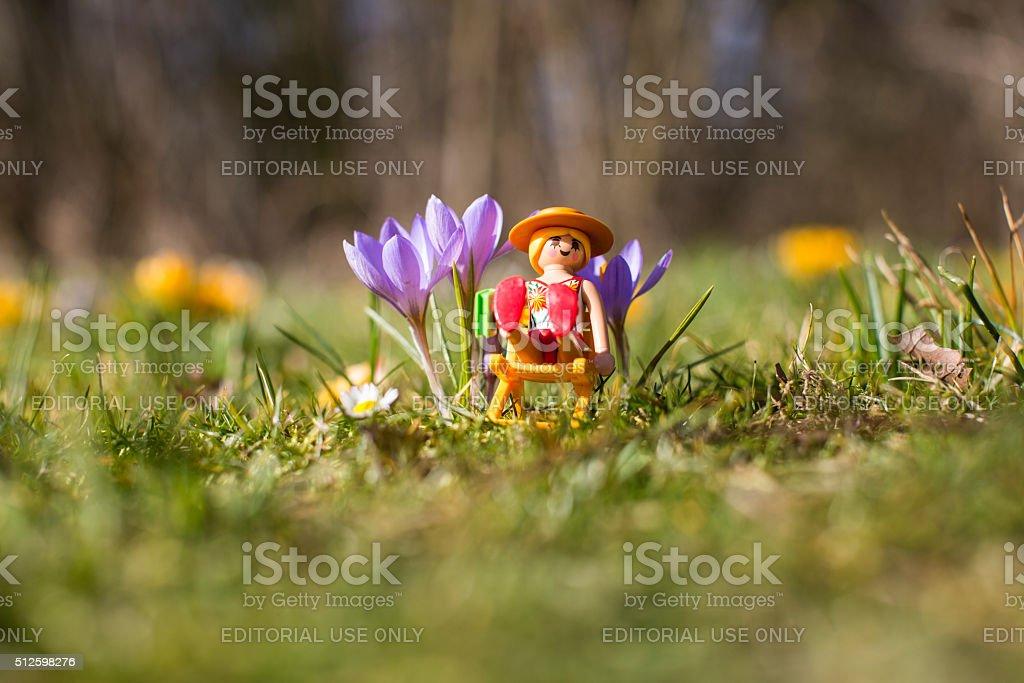 Playmobil woman figurine sunbathing on a long chair stock photo