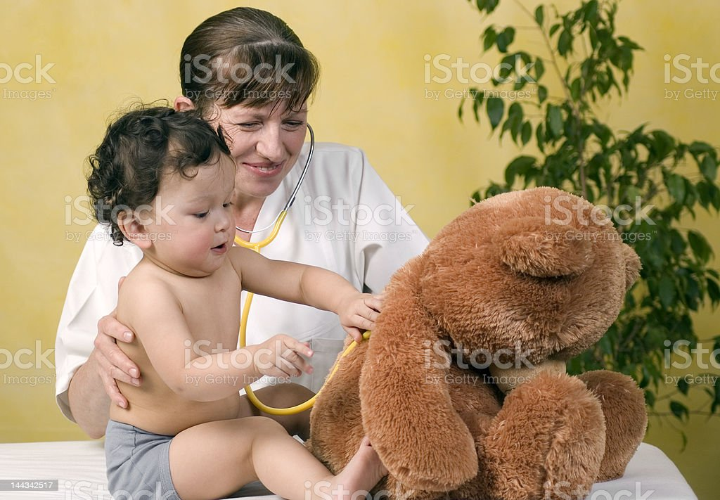 Playrful baby at the doctor. royalty-free stock photo