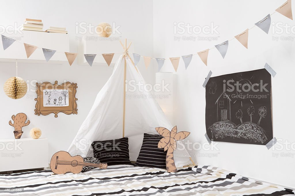 Playroom for kids with Teepee and garlands stock photo