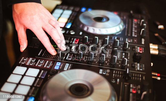 istock DJ plays and mix music on digital midi controller 1159661092