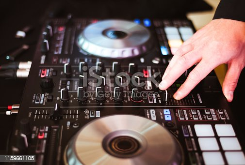 istock DJ plays and mix music on digital midi controller 1159661105
