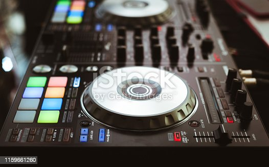 istock DJ plays and mix music on digital midi controller 1159661260