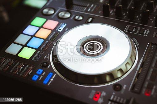 istock DJ plays and mix music on digital midi controller 1159661286