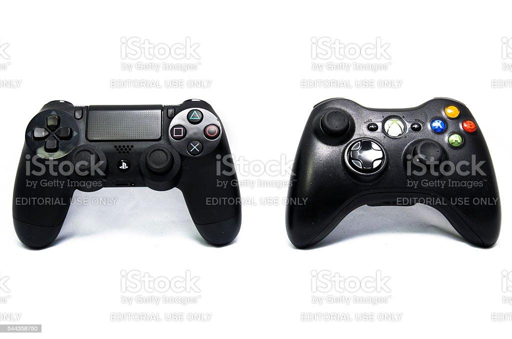 PlayStation4 and Xbox360 joysticks isolated on white stock photo