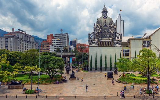 Cityscape over Plaza Botero Square with people walking, Medellin, Colombia.