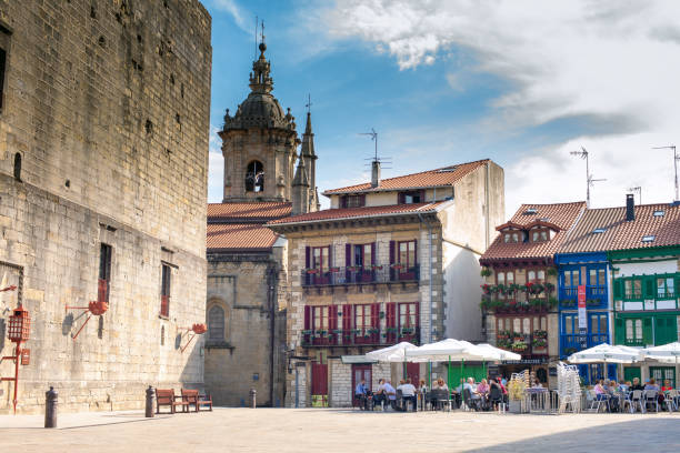 Plaza de Armas, main square of Hondarribia. Spain. Hondarribia, Gipuzkoa, Spain - September 30, 2016: Plaza de Armas, main square of Hondarribia.   Standing at the mouth of the River Bidasoa, Hondarribia is a town on the Guipuzcoa coast with a long seafaring and tourist tradition. Hondarribia boasts a well-preserved old town that is surrounded by a fortified wall, the only one to be found in Guipuzcoa province. The Old Town is loaded with beautiful Basque houses and some baroque buildings. The other main touristic attraction of Hondarribia is its beach, which stretches 800 m. palace of charles v stock pictures, royalty-free photos & images
