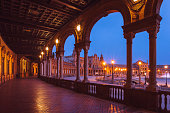 Evening view of the walkway along Plaza de España in Seville, built in 1928 for the Ibero-American Exposition.